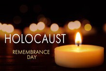 International Holocaust Remembrance Day. Burning Candle On Black Table, Closeup