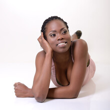 Beautiful Young African Woman Smiling And Looking Right, Over White