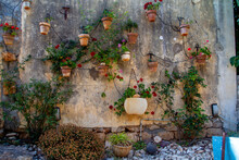 Wall Of Hanging Plant Pots With Flowers And Irrigation Systemat The Midrechov Street In Zichron Yaakov Israel