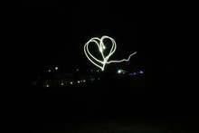 """The Inscription """"I Love You"""" Made With Light On A Black Background With Exposure"""