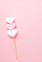 White And Pink Heart Shaped Marshmallows On A Wooden Stick On A Pink Background With Copy Space