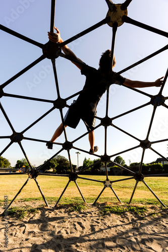 Photo Relaxing on a playground climbing dome