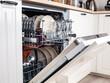 Leinwandbild Motiv dishwasher close-up with washed dishes, easy to use and save water, eco-friendly, built-in kitchen dish washing machine