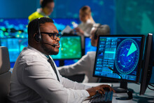 Workplace Of The Air Traffic Controllers In The Control Tower. Diverse Team Of Aircraft Control Officers Works Using Radar, Computer Navigation And Digital Maps. Aviation Concept.
