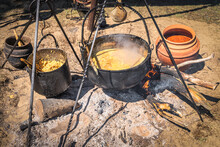 Stew Or Soup In Iron Pot Or Cauldron On A Campfire. Homemade Food At Historical Reenactment Of Slavic Or Vikings Lifestyle From Around 11th Century, Cedynia, Poland