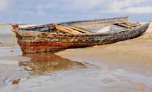 Old Wooden Boat At Low Tide In Zanzibar, Africa