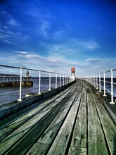 The East Pier At Whitby On The North Yorkshire Coast.