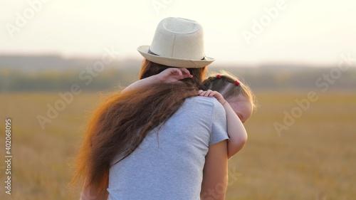 Valokuvatapetti Happy little daughter loves mom, child and mother hug in park