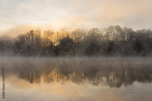 Fotografie, Tablou Fog on the water of Lake Lanier in Georgia, USA in winter at sunrise