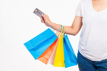 Happy Woman Hand Holding Shopping Bags Multicolor And Credit Card For Shopping Online, Young Female Hold Many Packets Within Arms Isolated On White Background, Black Friday Sale Concept