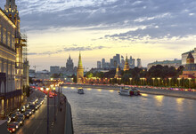 Evening On The Moscow River. The Medieval Walls Of The Kremlin Towers, Embankment, Night, Lights, Moscow-city District On The Horizon