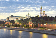 Moscow Kremlin In The Evening Lights. Medieval Fortress Walls, High Towers, Cathedrals, Ivan The Great Bell Tower, Kremlin Palace