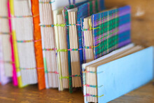 Spine Of Notebooks With Recycled Materials. Fabric Quadrille Covers