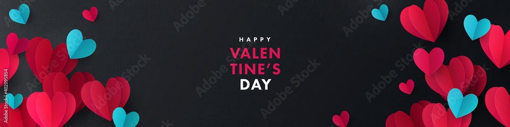 Fototapeta Happy Valentines Day banner. Holiday background design with frame made of pink, red, blue origami paper hearts on black fabric background. Horizontal poster, flyer, greeting card, header for website
