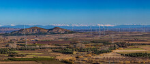 Panoramic View Of A Wind Farm With The Pyrenees Mountain Range In The Background
