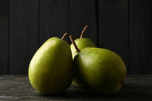 Fresh Green Pears On Wooden Background, Close Up