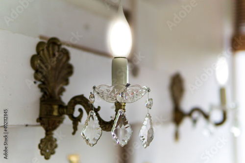 Old Wall lamp made of Brass with a blown glass Plate and Drops Fototapet