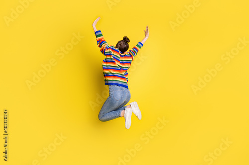 Fotomural Full size back rear spine view photo of pretty girl jump up air raise hands wear