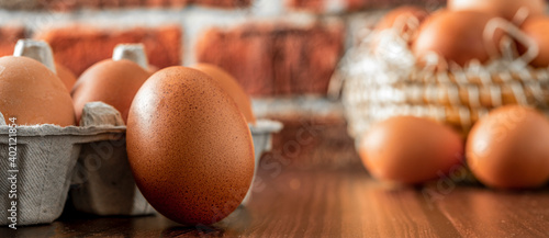 Fotografie, Obraz Close-up view of raw chicken eggs on wooden background