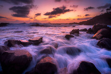 A Landscape Of The Sea With Long Exposure Surrounded By Rocks During A Breathtaking Sunset