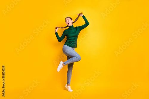 Obraz Full length body size photo female student laughing dancing cheerful enjoying isolated on vibrant yellow color background - fototapety do salonu