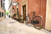 An Old Bike On One Of The Many Narrow Alleys Of Corfu Old Town,Greece