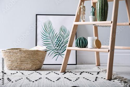 Fotografia Stylish wooden ladder in modern room interior, closeup