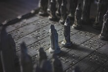 A Portrait Of A Stone Chess Board. The Game Of Strategy Is Just Begon With Two Pawns Of Each Army Facing Eachother In The Duel.
