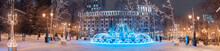 Wide Panoramic View Of The Illuminated With Garlands And Twinkling Lights Fountain In The Center Of Ufa, Russia. Christmas And New Year Decorations And Holidays.