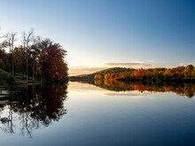 Keystone Lake In Keystone State Park In West Moreland Country In The Laurel Highlands Of Pennsylvania In The Fall With The Foliage Tree Line Reflecting In The Water.