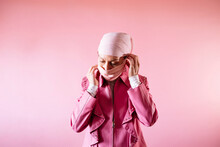 Woman With Headscarf And Pink Mask, Cancer Patient.