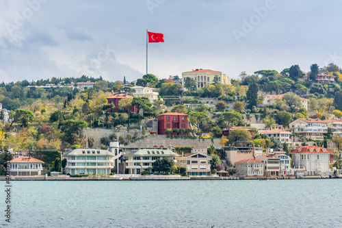 Canvas Turkish national flag and modern buildings along the Bosphorus strait in Istanbu