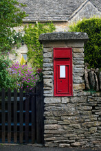 Old Red Post Box Set In Stone Wall For Use As A Background