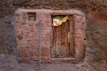 Carved Wooden Door On A Rock Wall Which Is The Monastery Facade Of An Ethiopian Monastery