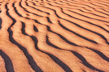 Harmonious Lines Of Sand In The Desert At Sunset; Bizarre Wind Patterns In The Soft Light Of The Setting Sun