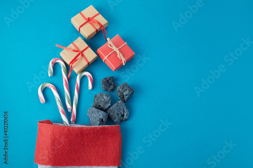 Sweet coal and candy with gift box in sock. Typical things for Epiphany day or Dia da Reyes Magos
