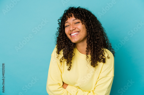 Young african american afro woman isolated laughing and having fun Wallpaper Mural