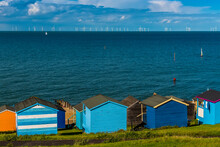 A View Across The Beach Huts At Tankerton Out Into The Thames Estuary In Summer