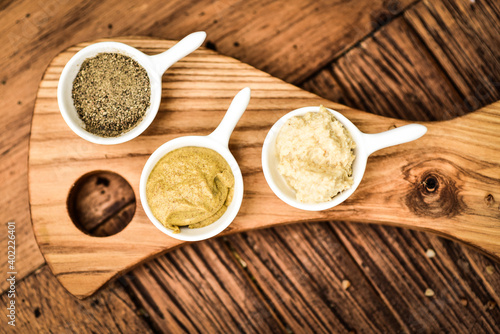 Fototapeta Herbs and spices on an ash serving board. obraz