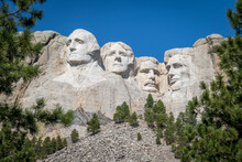 "The Carved Busts Of George Washington, Thomas Jefferson, Theodore ""Teddy"" Roosevelt, And Abraham Lincoln At Mount Rushmore National Monument"