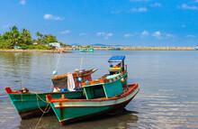 Vietnamese Fishing Boats On Tropical Island Shore