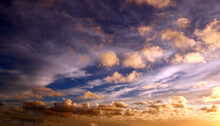 View From The Coast Of The Easter Island, Of Colorful Sunset Sky Covered By White Clouds, Over The Pacific Ocean.