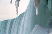 Looking Through The Ice Cave Behind Ontario's Niagara Falls As Vapor Rises Over Melting Icicles