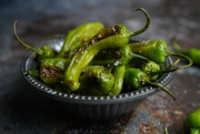 Blistered Shishito Peppers In A Bowl On Dark Moody Setting