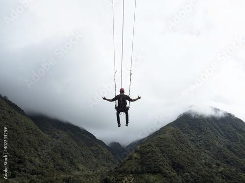 Tourist on giant swing adventure ride at Manto de la novia Bridal Veil waterfall Wallpaper Mural