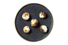 Top View Of Stuffed Mushrooms On A Plate With Black Texture And Golden Edges.