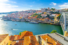 Aerial Panoramic View Of Porto Oporto City Historical Centre With Ribeira District Colorful Buildings Houses On Embankment Of Douro River And Ponte Dom Luis I Bridge, Norte Or Northern Portugal