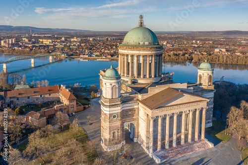 Photo Hungary - Historical Basilica of Esztergom from drone view near Danube river