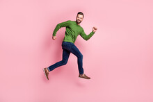 Full Length Body Size Profile Side View Of Attractive Cheerful Guy Jumping Running Fast Isolated Over Pink Pastel Color Background