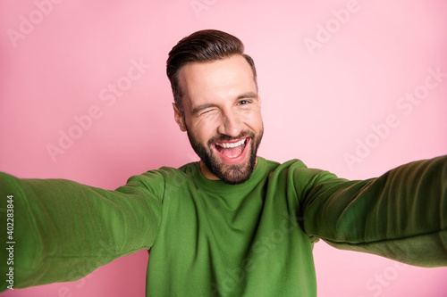 Fotografie, Obraz Self-portrait of nice cheerful mature funky guy having fun winking isolated over